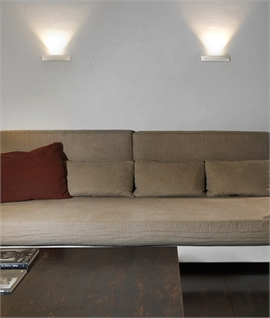 Curvy LED wall uplight in polished chrome or white finish
