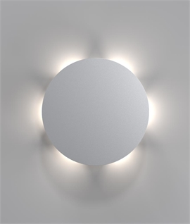 Striking Round Back Lit Wall Light