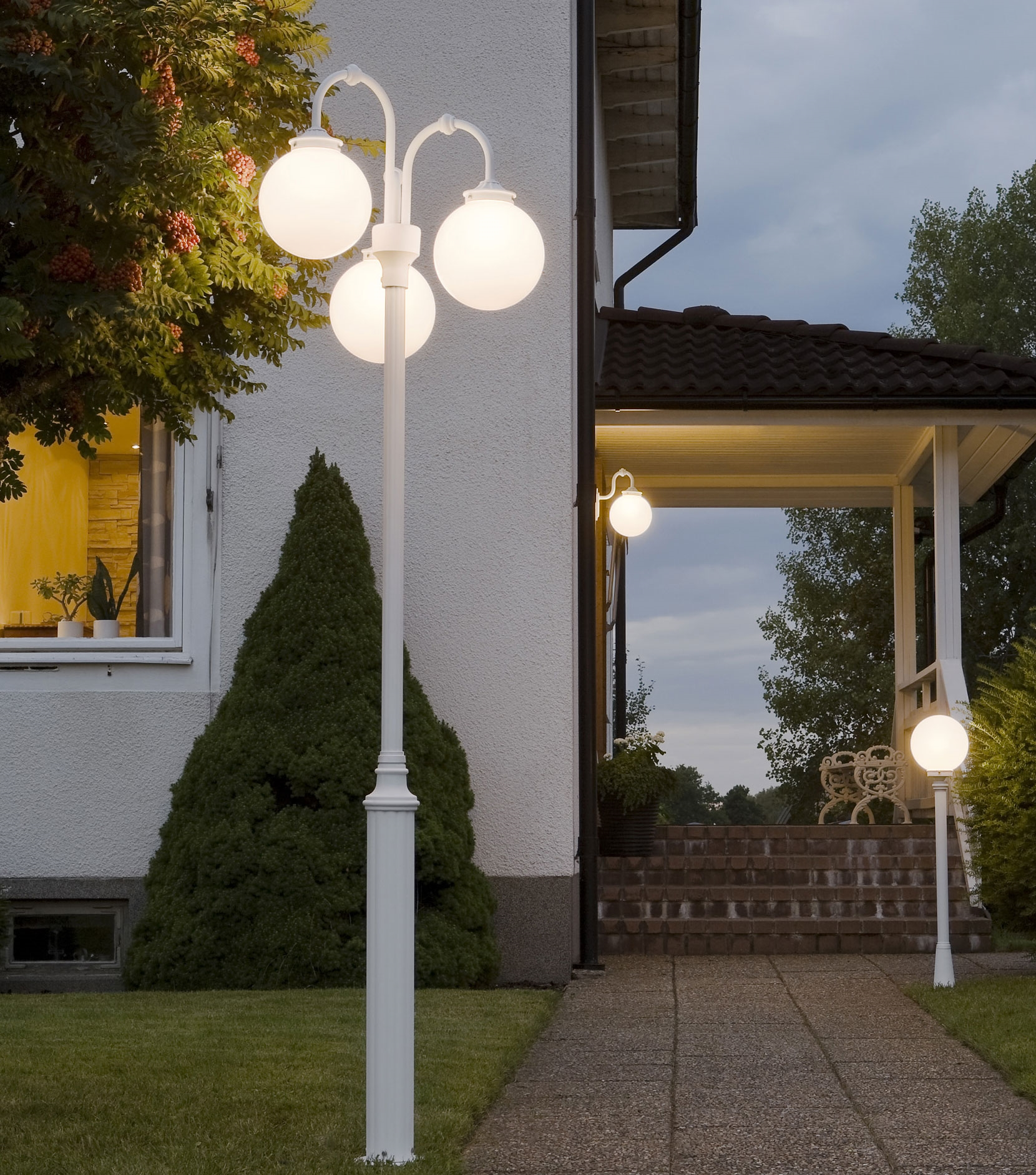 Classical Outdoor Lamp Post With Three Opal Globes On A White Pole