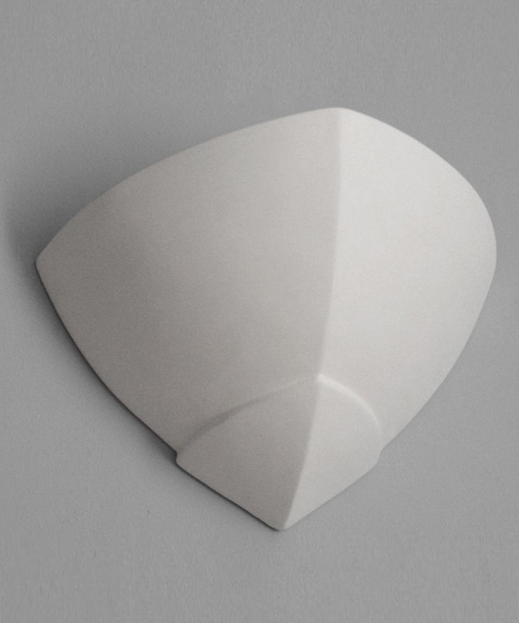 Wall and corner uplight in a pointed corbel design