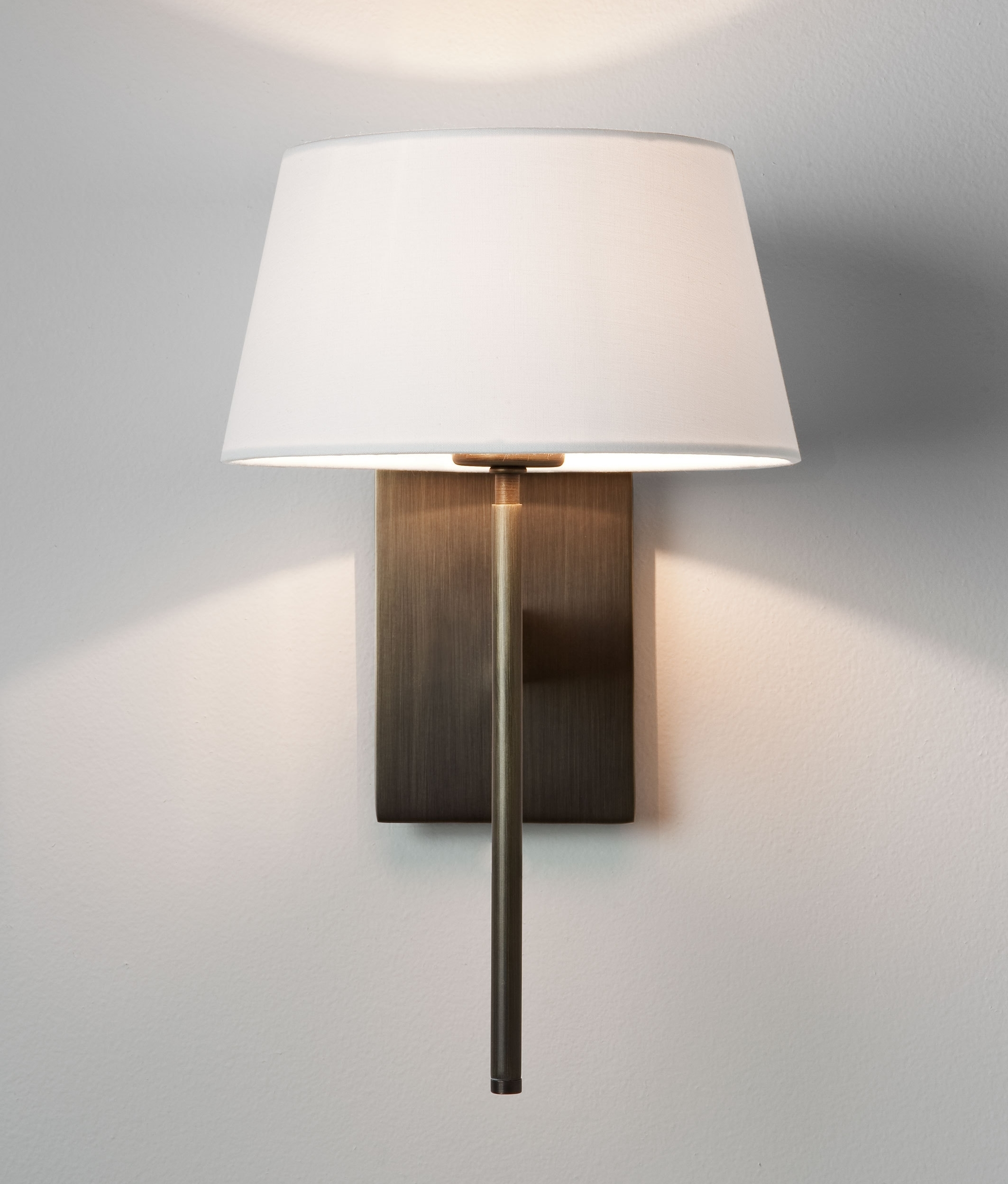 elegant wall light with fabric shade is available in three finishes