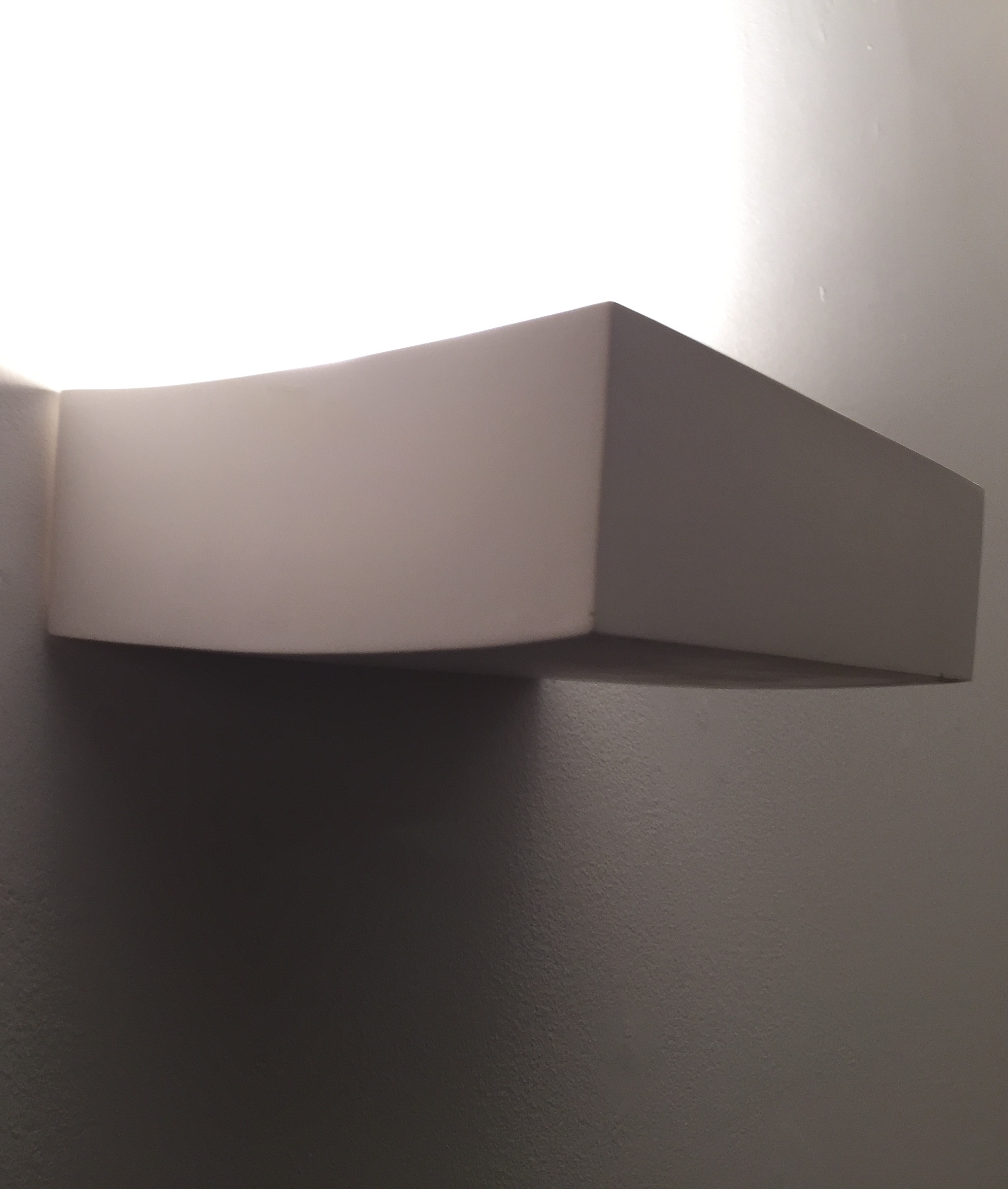 Curved Plaster Wall Lights : Curved and compact a plaster wall light in a natural finish