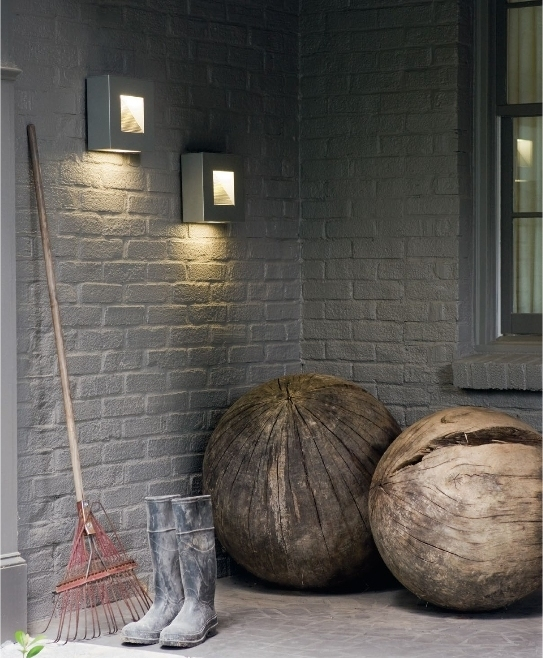 Sleek Sloped Led Wall Light For Exterior Installation And